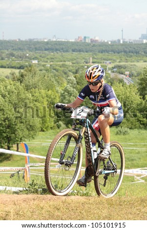 MOSCOW, RUSSIA - JUNE 9: Pauline Ferrand Prevot (France) races during the European Mountain Bike Cross-Country Championship in Moscow, Russia at June 9, 2012