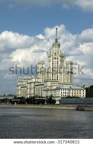 """MOSCOW, RUSSIA - JUNE 11, 2010: Residential building on Kotelnicheskaya embankment in Moscow, one of the """"high-rise buildings"""", Stalin style architecture. View from Moscow river - stock photo"""