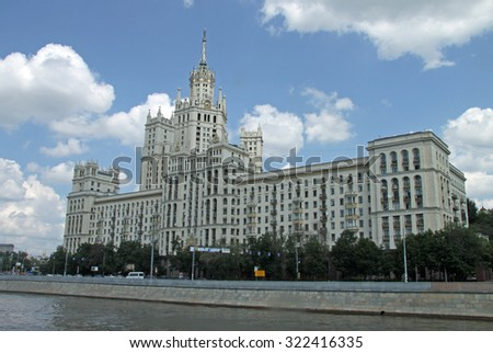 """MOSCOW, RUSSIA - JUNE 11, 2010: Residential building on Kotelnicheskaya embankment in Moscow, one of the """"high-rise buildings"""", Stalin style architecture. View from Moskva (Moscow) river - stock photo"""