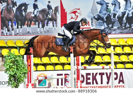 MOSCOW, RUSSIA - JUNE 26: Rider Dyshaeva Elena(RUS) with a Dutch Warmblood horse Miss Kenwood competes at the International event CSI4*RR/ Russian Championship Show Jumping on June 26, 2011 in Moscow, Russia