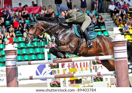 MOSCOW, RUSSIA-JUNE 26: Rider Pint Victory (RUS) with a German warmblood horse Aragorn competes at the International event CSI4*RR/ Russian Championship Show Jumping on June 26, 2011 in Moscow,Russia