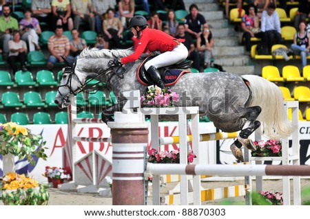 MOSCOW, RUSSIA - JUNE 26:rider Simony Natalia(RUS) at the holsten horse Solana13 in stage of the International event CSI4*RR/ Russian Championship Show Jumping on June 26, 2011 in Moscow, Russia