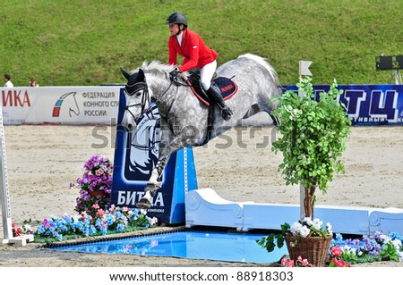 MOSCOW, RUSSIA - JUNE 26: Rider Simony Natalia(RUS) with a Holsten horse Solana13 competes at the International event CSI4*RR/ Russian Championship Show Jumping on June 26, 2011 in Moscow, Russia