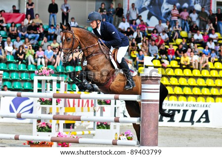 MOSCOW, RUSSIA-JUNE 26: Rider Tuganov Vladimir (RUS) with a Holsten horse Amarok competes at the International event CSI4*RR/ Russian Championship Show Jumping on June 26, 2011 in Moscow, Russia