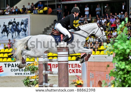 MOSCOW, RUSSIA - JUNE 26:rider Varna Andis(LAT) at the latvian horse Marmors in stage of the International event CSI4*RR/ Russian Championship Show Jumping on June 26, 2011 in Moscow, Russia