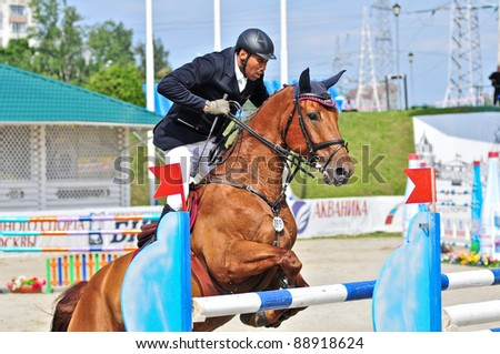 MOSCOW, RUSSIA-JUNE 26: Rider Vaskov Ibrahim(BLR) with a Oldenburg horse La Pass competes at the International event CSI4*RR/ Russian Championship Show Jumping on June 26, 2011 in Moscow, Russia