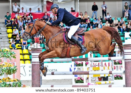 MOSCOW, RUSSIA-JUNE 26: Rider Vaskov Ibrahim (BLR) with a Oldenburg horse La Pass competes at the International event CSI4*RR/ Russian Championship Show Jumping on June 26, 2011 in Moscow, Russia