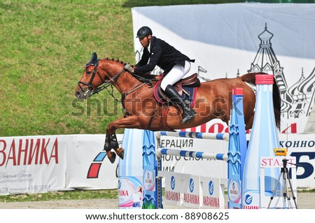 MOSCOW, RUSSIA-JUNE 26: Rider Vaskov Ibrahim(BLR) with a Oldenburg horse La Pass participates at the International event CSI4*RR/ Russian Championship Show Jumping on June 26, 2011 in Moscow, Russia