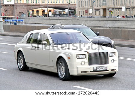 MOSCOW, RUSSIA - JUNE 3, 2012: White premium class sedan Rolls-Royce Phantom SWB at the city street. - stock photo