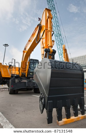 MOSCOW, RUSSIA - JUNE 02:  Yellow diesel excavator on display at Moscow International exhibition Construction equipment and technologies on JUNE 02, 2010 in Moscow, Russia.
