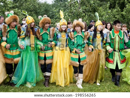 MOSCOW, RUSSIA - June 14: Yhy?kh - Festival of  summer solstice. Yakuts in national dress   are dancing in round dance - Ohuokhai  that  means  circle of life. June 14, 2014, Moscow, Russia - stock photo