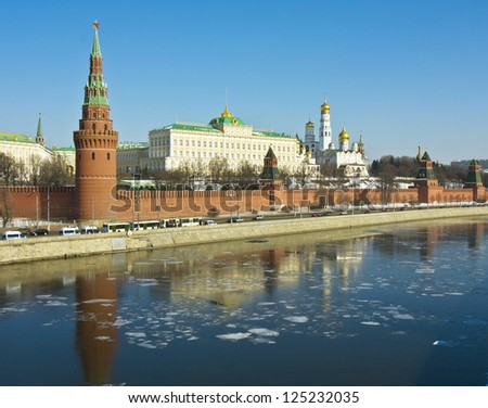 Moscow, Russia, Kremlin fortress with palace and cathedrals on bank of Moscow-river in spring, ice on water. - stock photo