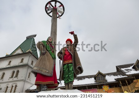 MOSCOW, RUSSIA - MAR 17: Celebration of  traditional russian holiday Shrovetide with Russian fun climbing on a column with gifts March 17, 2013 in Moscow, Russia  - stock photo