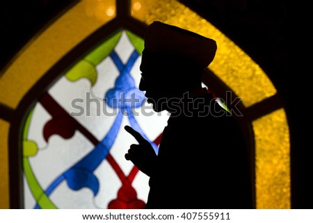 MOSCOW, RUSSIA - MAR 27, 2016: Mullah prays in the Moscow Cathedral mosque during Quranic Festival in Moscow, Russia