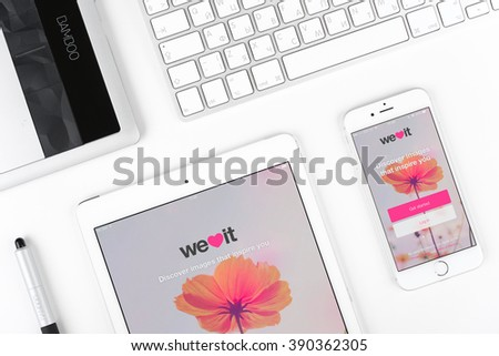 Moscow, Russia - March 12, 2016: Apple iPhone 6 and iPad displaying We Heart It application. We Heart It is an image-based social network for inspiring images. - stock photo