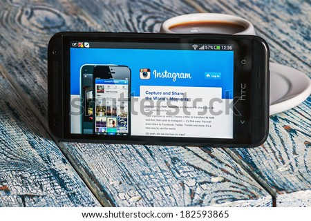 Moscow, Russia - March 18, 2014:instagram app open in the mobile phone HTC.HTC Corporation main direction rapidly developing market of smartphones. Instagram free application sharing photos and videos - stock photo