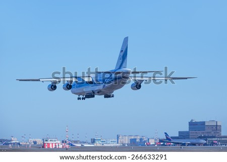 MOSCOW, RUSSIA - MARCH 17, 2015: Landing of the big airliner in Sheremetyevo airport, Moscow, March 17, 2015.