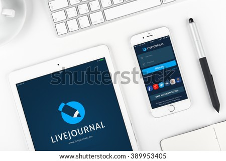 Moscow, Russia - March 12, 2016: Livejournal on display of iPad and iPhone. Livejournal is a social networking service, where Internet users can keep a blog, journal or diary - stock photo