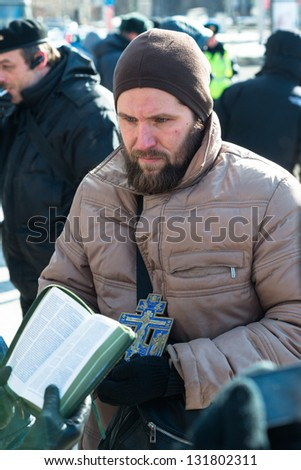 MOSCOW, RUSSIA - 8 MARCH: Orthodox activists read Bible aloud on picket to free Pussy Riot members on March 8, 2013 in Moscow.