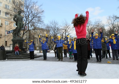 MOSCOW, RUSSIA - MARCH 6: Participants take part in a group fitness session at Tver Boulevard near the monument Yesenin, March 6, 2010 in Moscow, Russia.