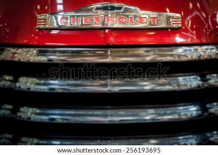 Moscow, Russia - March 3, 2013: Radiator grille and badge of a red classic vintage Chevrolet car, close up detail. - stock photo