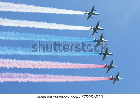 MOSCOW, RUSSIA - MAY 7, 2015: A group of aircraft in-flight smoke color Russian flag. Rehearsal of parade devoted to May 9, 70-th Victory Day in World War II. May 7, 2015 in Moscow.  - stock photo