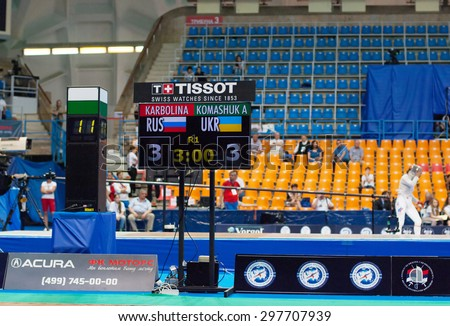 MOSCOW, RUSSIA - MAY 31 2015: A. Komashuk and E. Karbolina score board on the World  fencing Grand Prix Moscow Saber in Luzhniki sport palace - stock photo