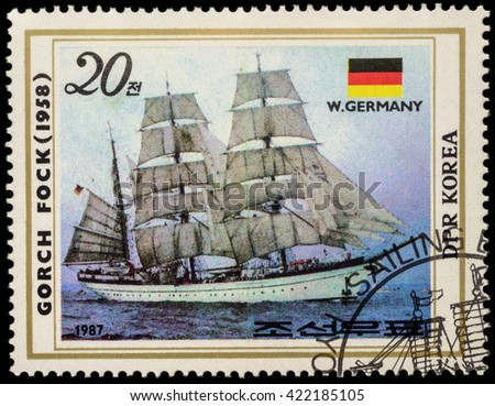 "MOSCOW, RUSSIA - MAY 17, 2016: A stamp printed in DPRK (North Korea) shows image of ""Gorch Fock II"", a tall ship of the German Navy (1958) and flag of Germany, series ""Sailing Ships"", circa 1987"