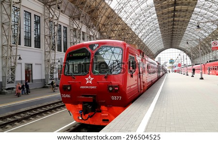 MOSCOW, RUSSIA - MAY, 14 2015: Aeroexpress red Train on Kiyevskaya railway station  (Kiyevsky railway terminal,  Kievskiy vokzal) -- is one of the nine main railway stations of Moscow, Russia