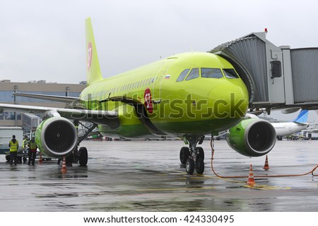 MOSCOW, RUSSIA - MAY 19, 2016: Airbus A319 S7 airlines plane waits for luggage on the platform of the international airport Domodedovo.