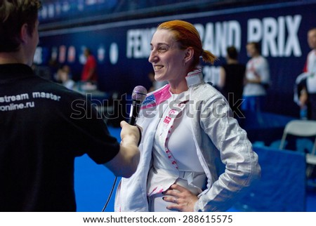 MOSCOW, RUSSIA - MAY 31 2015: Alexandra Shatalova gives an interview just after fight on the World  fencing Grand Prix Moscow Saber in Luzhniki sport palace - stock photo