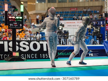MOSCOW, RUSSIA - MAY 31 2015: Alina Komashuk and Eugenia Karbolina fights on the World  fencing Grand Prix Moscow Saber in Luzhniki sport palace - stock photo