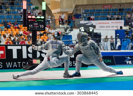 MOSCOW, RUSSIA - MAY 31 2015: Alina Komashuk versus Eugenia Karbolina on the World  fencing Grand Prix Moscow Saber in Luzhniki sport palace - stock photo