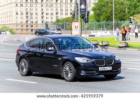 MOSCOW, RUSSIA - MAY 6, 2012: Black luxury car BMW F07 5-series GT in the city street. - stock photo