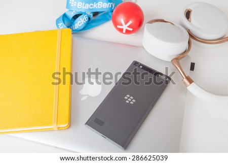 Moscow, Russia - May 25, 2015: BlackBerry Leap back, Apple MacBook Pro Retina, Parrot Zik ear-flaps and accessorizes. Smart phone was released at Mobile World Congresson March 3, 2015.