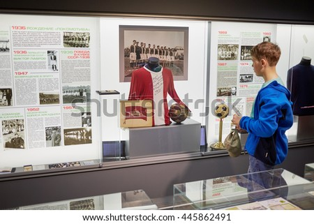 MOSCOW, RUSSIA - MAY 26, 2015: Boy (with model release) at the Locomotive soccer club museum. Museum was opened on November 24, 2011. - stock photo