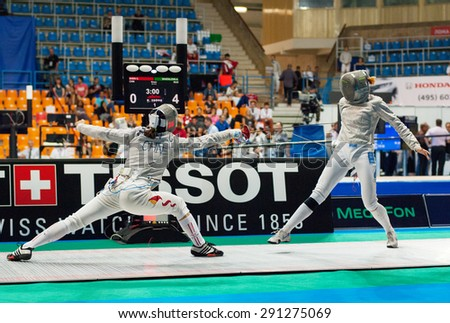 MOSCOW, RUSSIA - MAY 31 2015: C. Shen and A. Shatalova fights on the World  fencing Grand Prix Moscow Saber in Luzhniki sport palace - stock photo