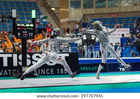 MOSCOW, RUSSIA - MAY 31 2015: C. Shen versus A. Shatalova fights on the World  fencing Grand Prix Moscow Saber in Luzhniki sport palace - stock photo