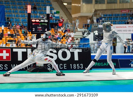 MOSCOW, RUSSIA - MAY 31 2015: C. Shen vs A. Shatalova on the World  fencing Grand Prix Moscow Saber in Luzhniki sport palace - stock photo