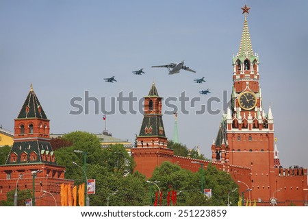 """MOSCOW, RUSSIA - MAY 9, 2010: Cargo military transport aircraft An-124 """"Ruslan"""" in support of su-29 in the sky at the Victory parade - stock photo"""