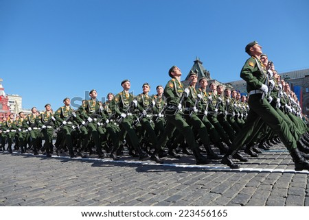 MOSCOW, RUSSIA - MAY 09, 2014: Celebration of the 69th anniversary of the Victory Day (WWII). Solemn marching of soldiers in Red Square. Cadets of the military Academy of logistics name A.C. Khrulyova - stock photo