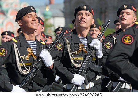 MOSCOW, RUSSIA - MAY 09, 2014: Celebration of the 69th anniversary of the Victory Day (WWII). Solemn marching of soldiers in Red Square. 336 guards Bialystok brigade of Marines of the Baltic fleet - stock photo