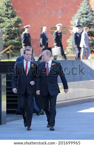 MOSCOW, RUSSIA - MAY 09, 2014: Celebration of the 69th anniversary of the Victory Day (WWII) on Red Square. President Vladimir Putin and Prime Minister Dmitry Medvedev came to the ceremony - stock photo