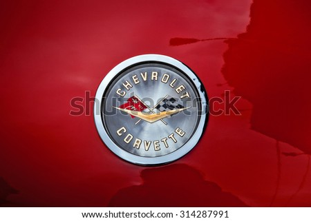MOSCOW, RUSSIA - MAY 05, 2015: 1959 Chevrolet Corvette Car Sign. From 1953 the Corvette is a sports car manufactured by Chevrolet division of American automotive conglomerate General Motors. - stock photo