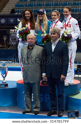 MOSCOW, RUSSIA - MAY 31 2015: E. Dyachenko, Y. Egoryan, S. Velikaya, O. Kharlan on pedestal just after World  fencing Grand Prix Moscow Saber in Luzhniki sport palace - stock photo