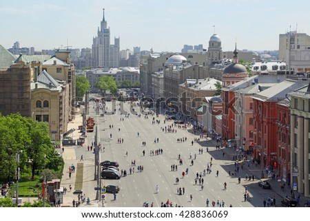 MOSCOW, RUSSIA - MAY 09, 2016: Festive events in the 71-th anniversary of Victory Day in WWII. Top view of the New square. People walking down the street - stock photo
