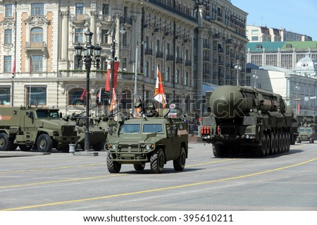 "MOSCOW, RUSSIA - MAY 07, 2015: GAZ-2330 ""Tigr"" - Russian multipurpose armored vehicle and rocket complex of strategic purpose with an Intercontinental ballistic missile RT-2??2 ""Topol-M"""