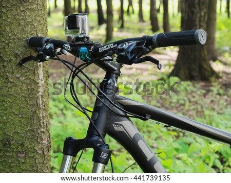 Moscow, Russia - May 29, 2016: GoPro Hero3+ Black Edition action camera mounted on mountain bicycle by CUBE in the forest