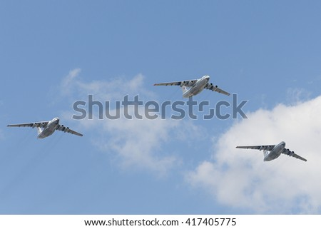 MOSCOW, RUSSIA - MAY 07, 2016: Group of Ilyushin Il-76MD cargo airplanes of Russian Air Force flying over the Red Square. Dress rehearsal of the Victory Day parade on Red Square.