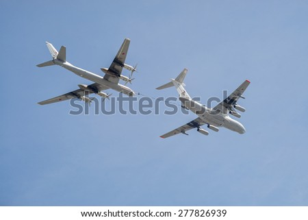MOSCOW/RUSSIA - MAY 7: Il-78 (Midas) aerial tanker and Tu-95MS (Bear) large strategic bombers and missile platform demonstrate refueling on parade devoted to Victory Day on May 7, 2015 in Moscow. - stock photo